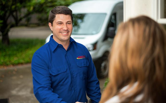 technician greeting customer at the door