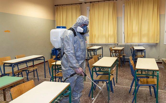 an amco tech disinfecting a classroom