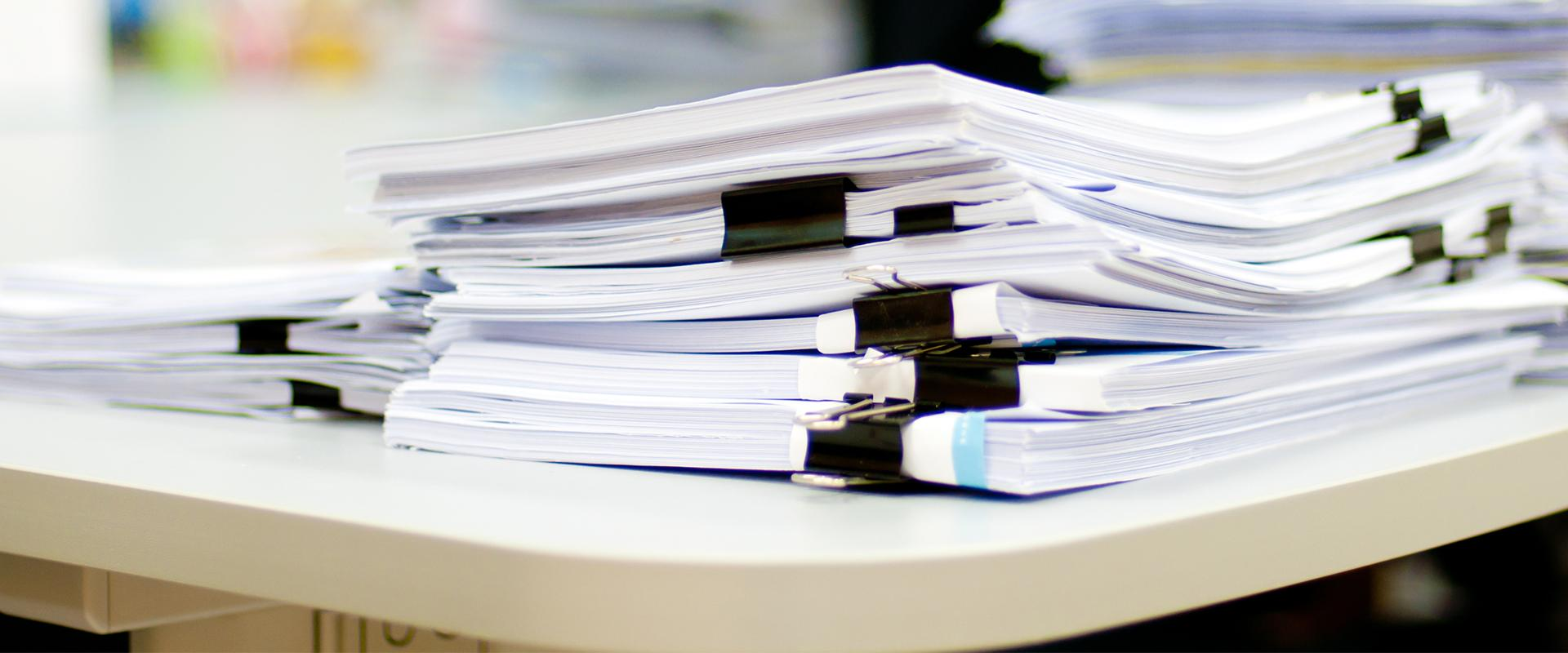 files of resources stacked on a desk