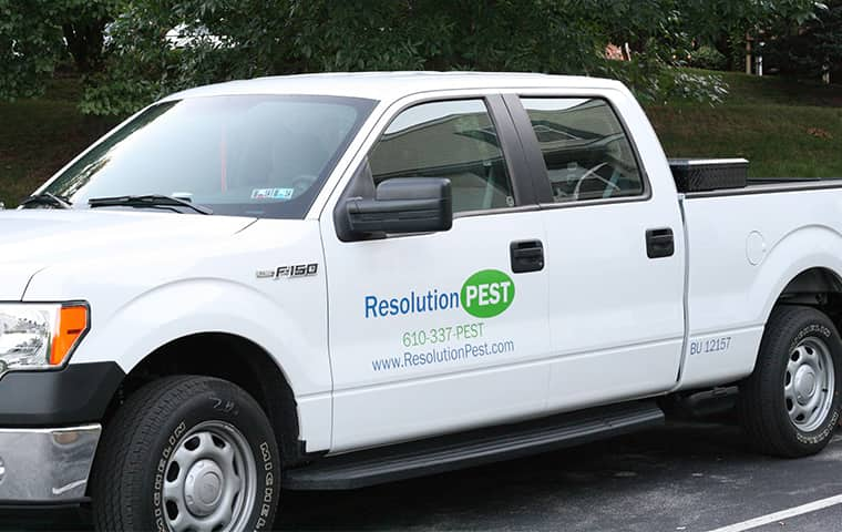 a resolution pest company vehicle parked outside of a home in wayne pennsylvania