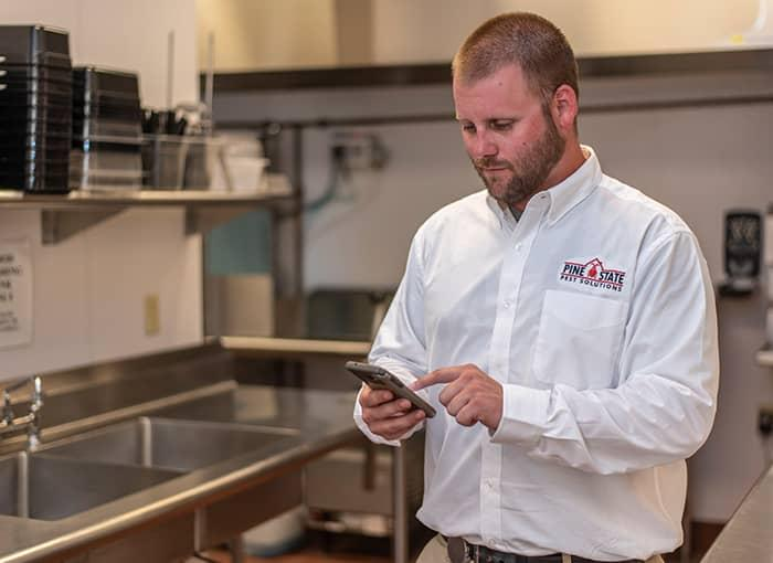 commercial pest control specialist inspecting for mice and rats