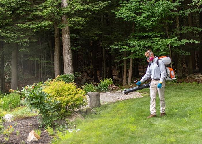 augusta me pest control tech spraying for ticks