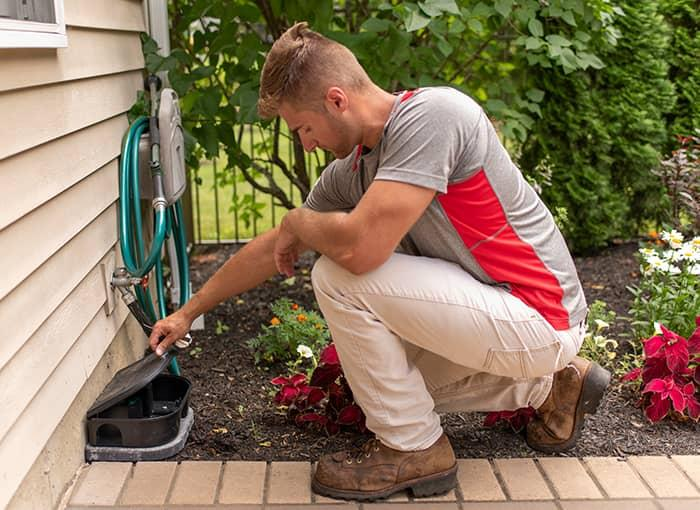 maine rodent control specialist checking rodent station in portland
