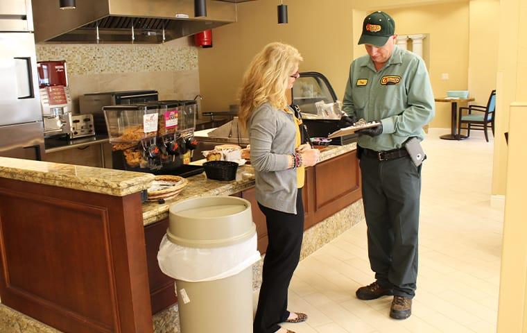 a pest control technician discusses commercial pest control with a business owner in anahuac texas