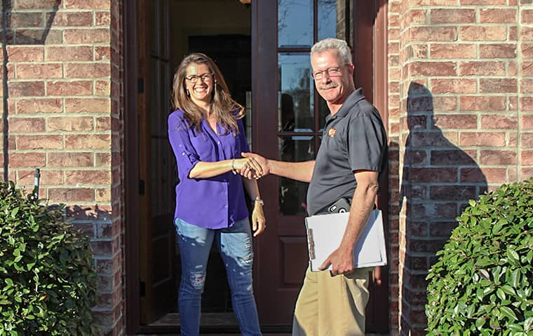 pest control technician greeting homeowner in bridge city texas