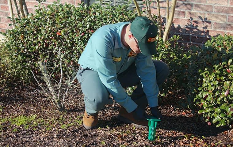 technician performing termite control in brookeland home
