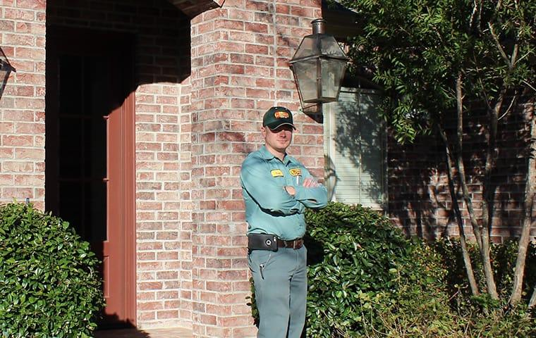 a pest control technician at a home in buna texas