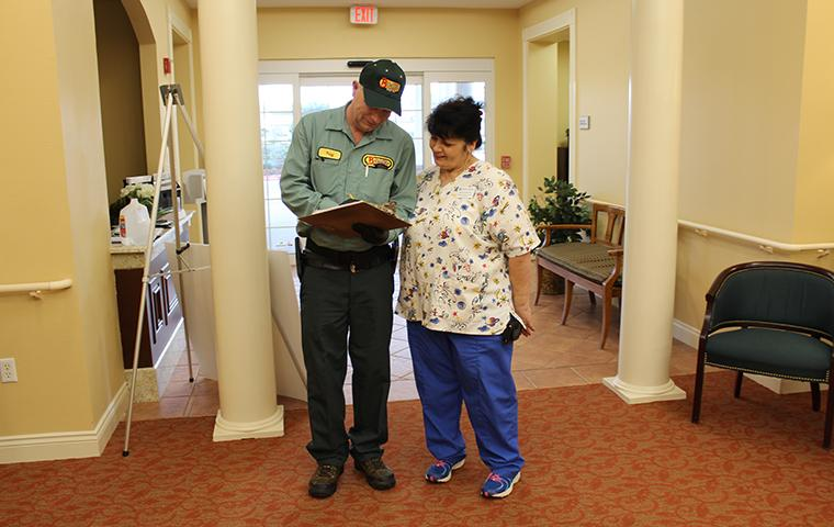 southeast tx pest control pro explaining service at nursing home