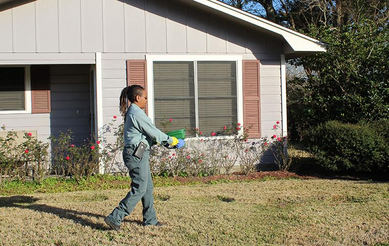 southeast pest control tech treating yard for fire ants