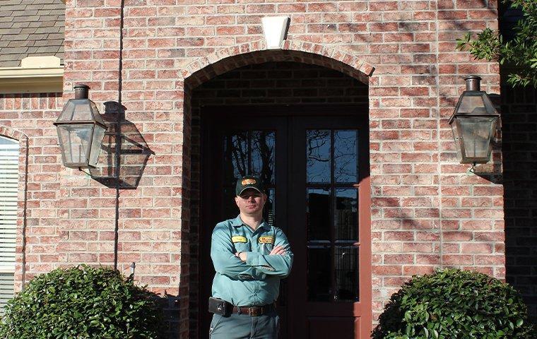a technician standing outside a home in kountze texas