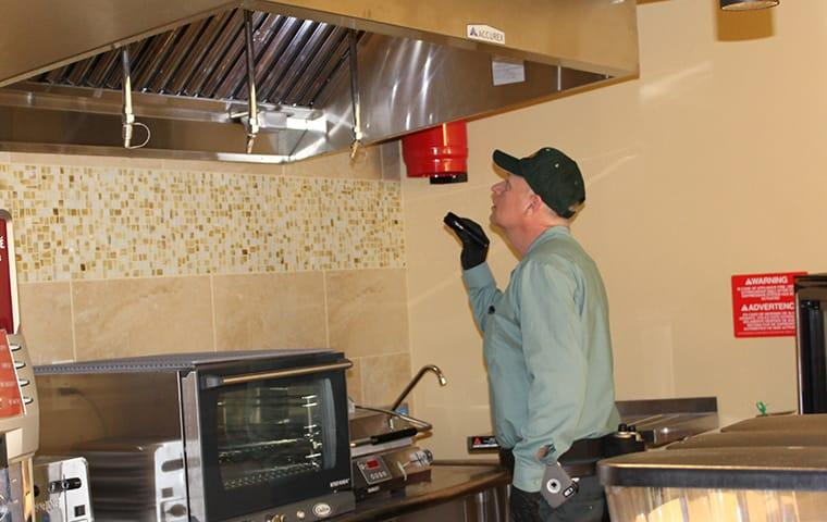 commercial technician checking fan