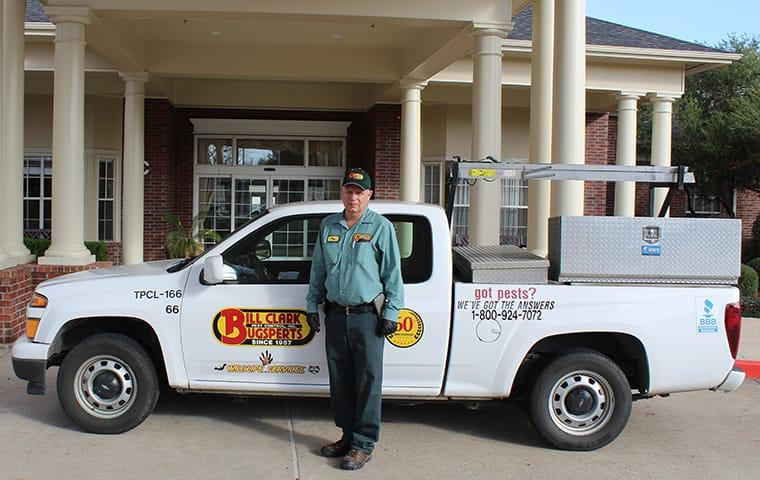 a technician standing outside a company vehicle and business in mauriceville texas