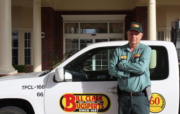 technician standing beside a truck