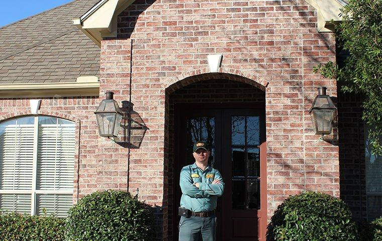 local pest expert in front of a home in stowell texas
