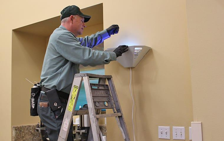 a pest control technician inspecting a commercial business for pests in woodlands texas