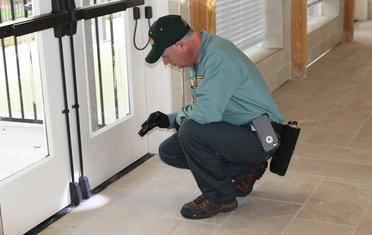 a pest control technician inspecting a commercial facility in woodville texas