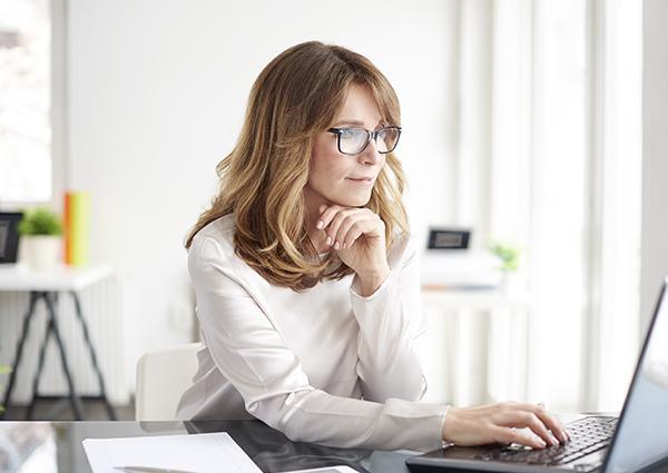 woman looking at facebook