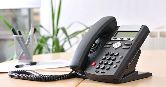 an office phone on a  desk
