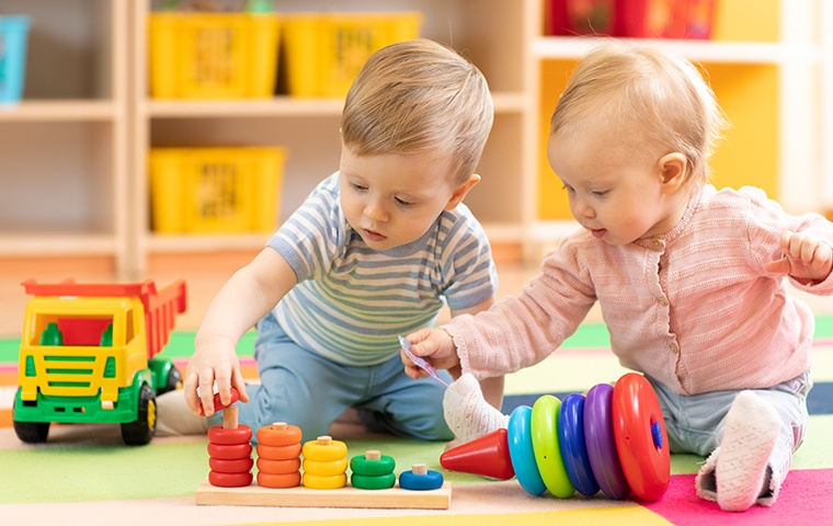two young children playing inside a daycare
