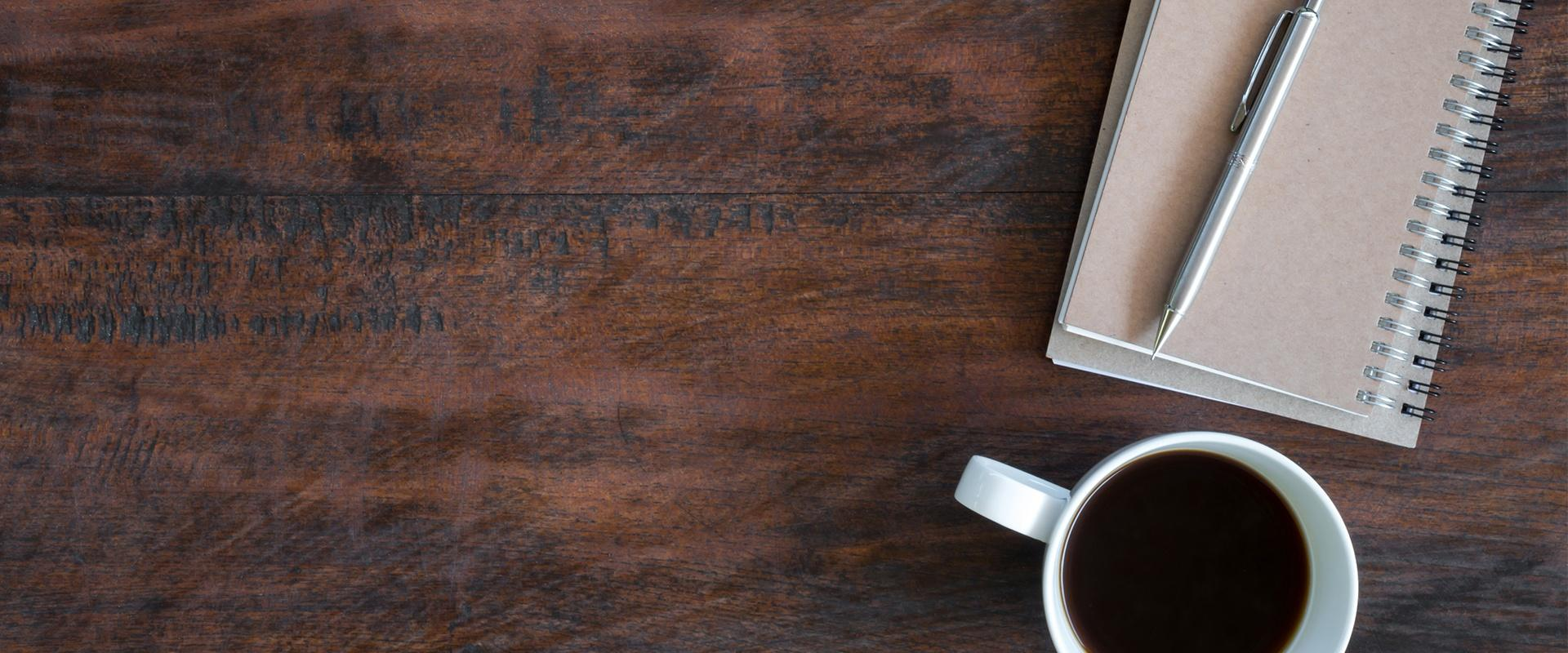 coffee cup on a wooden desk