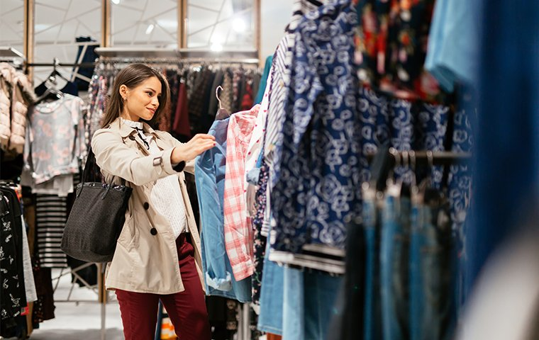a woman shopping in a clothing store