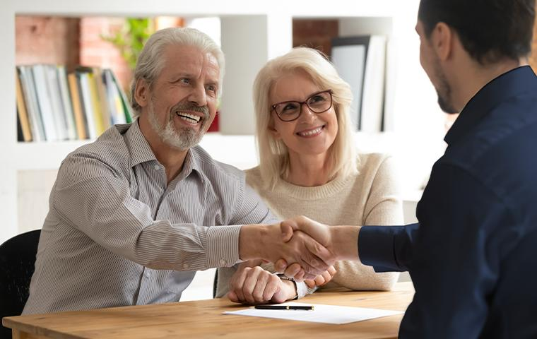 tech shaking hands with clients