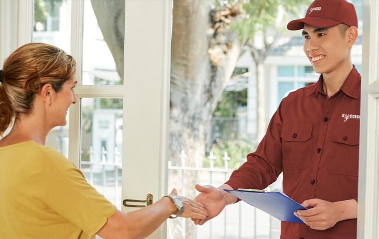 technician shaking homeowners hand in boerne texas