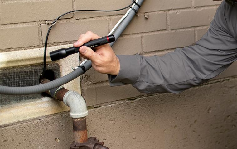 technician inspecting exterior in tarrant county texas