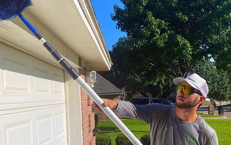 technician treating exterior in tarrant county texas