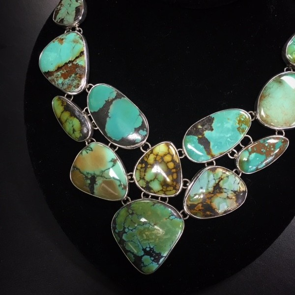 A stunning display of Natural Turquoise in an artisan made design of Taxco Silver.