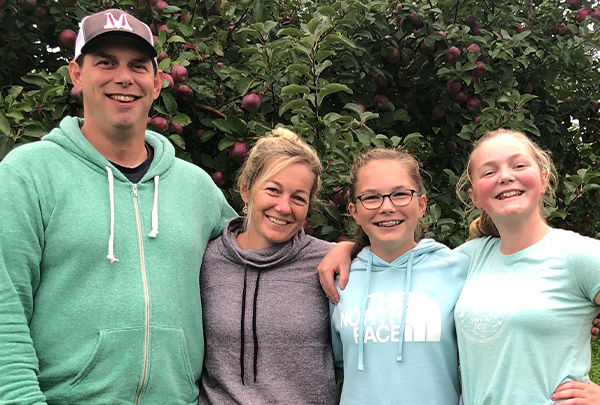 Trevor's wife, Sarah, and their teenage daughters join him for one of their favorite family outings, picking apples.
