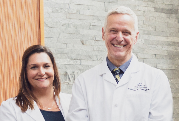 Dr. Christian Thomas with Melissa Timberlake FNP