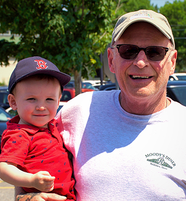 Kenny Ames with his grandson