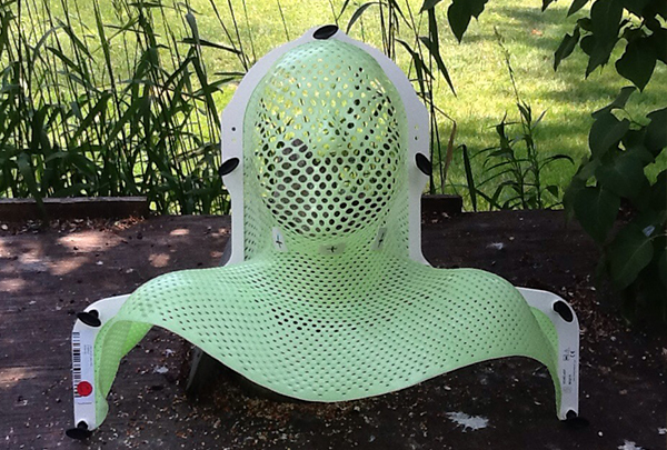 Green mask worn during radiation therapy