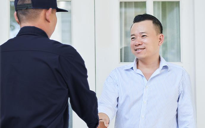 a technician greeting a customer