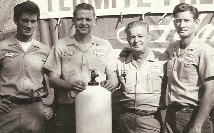 an old picture of admiral pest control technicians