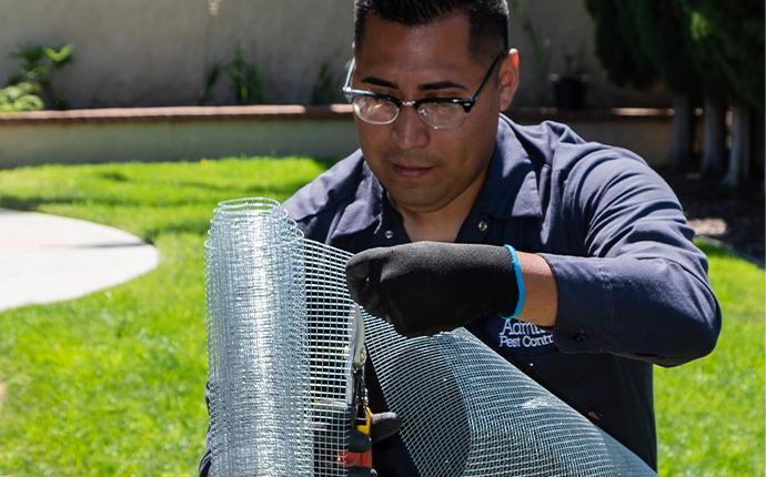 technician holding wire mesh