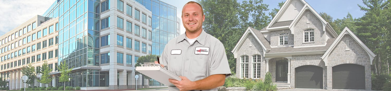 pest control tech in front of home and business in iowa
