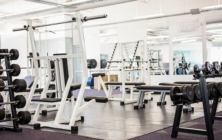 empty gym filled with gym equipment