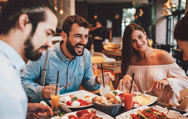 friends gathered around a restaurant table
