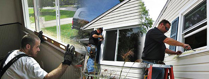 technicians installing new windows in a home in cleveland
