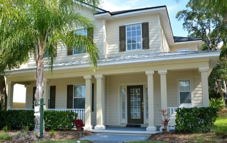 a large home with palm trees in winter springs florida