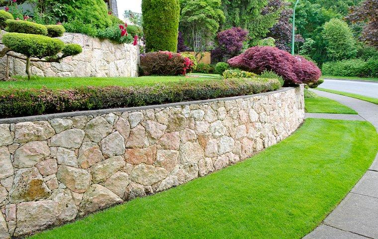 green lawn and stone walls