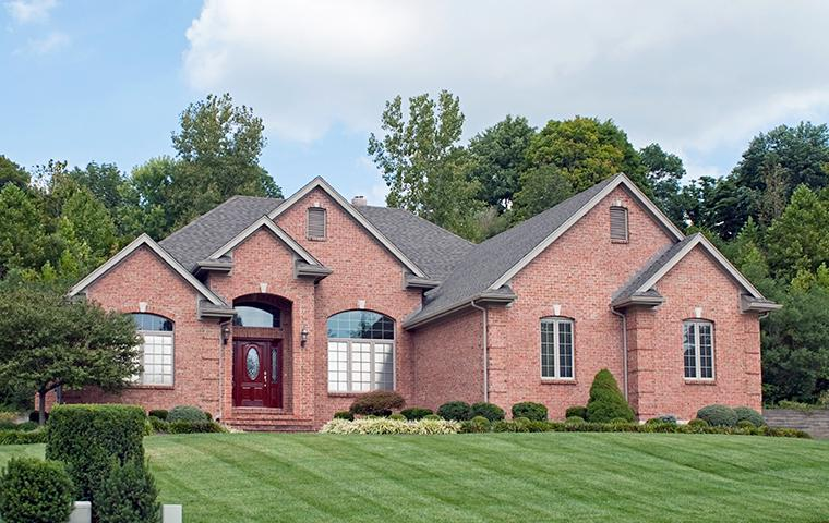 street view of large brick home