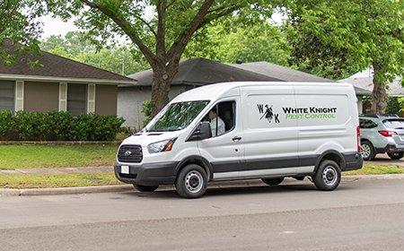 company van in front of home