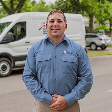 a pest technician standing in front of his service vehicle in modesto california