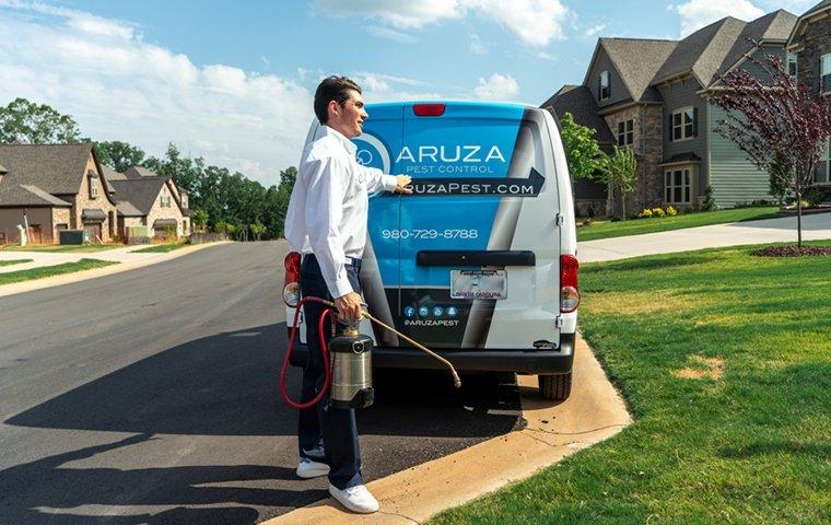 a pest control service technician arriving at a home in fort mill south carolina