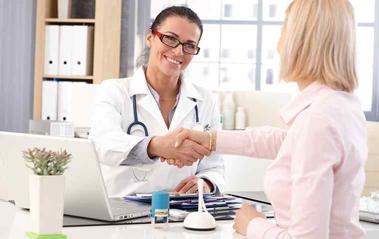 a friendly doctor greeting patient