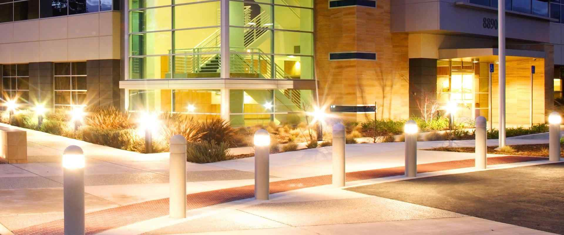 a commercial building at dusk with lights