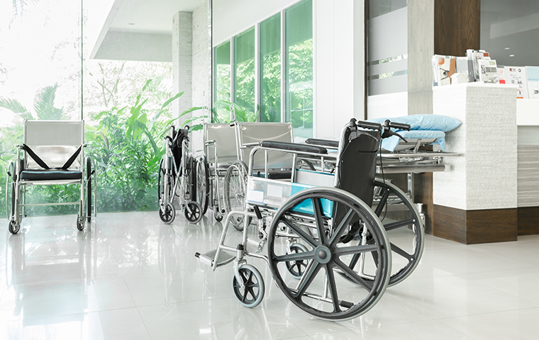 interior of a california hospital entryway filled with wheelchairs